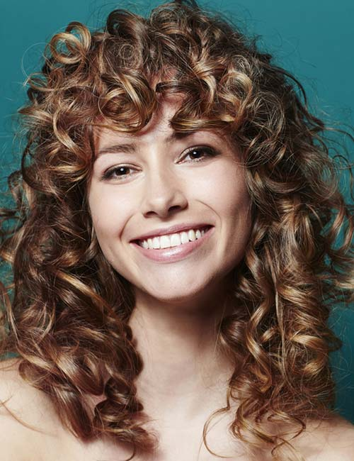 7. Shaggy Layers And Curly Bangs