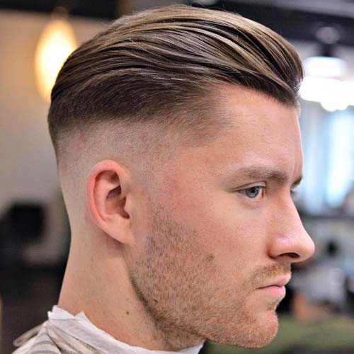 High Fade with Te xtured Slick Back and Stubble
