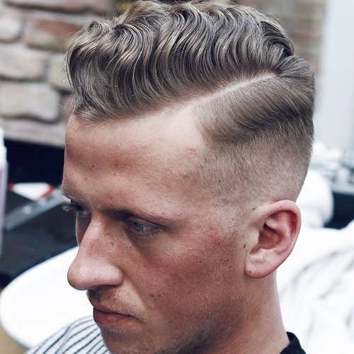 High Fade + Welliges Haar Kamm Over + Part